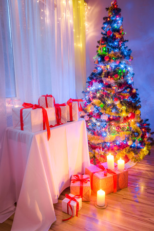 Traditionally Christmas tree with gifts for Christmas eve