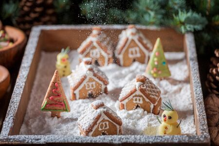 Cute Christmas gingerbread village with snowman and trees