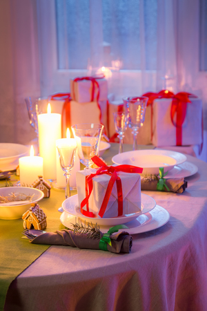 Beautiful Christmas table setting with candles and gingerbread Stock Photo
