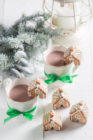 Homemade gingerbread cottages with sweet drink for Christmas Stock Photo