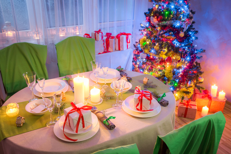 Family Christmas table setting with present and tree