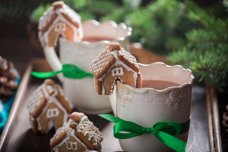 Homemade gingerbread cottages with sweet drink as Christmas snack Stock Photo