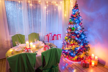 Beautiful Christmas table setting for Christmas eve in frosty evening