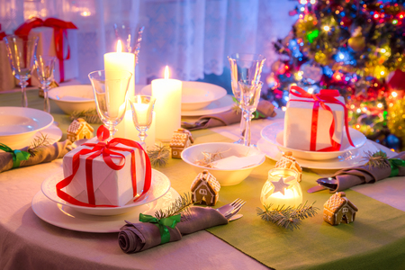 Traditionally Christmas table setting with green and white decoration
