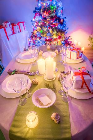 Moody Christmas table setting with Christmas tree Stock Photo
