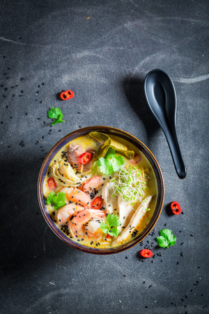 Tasty Malaysian Soup with chicken and shrimps Stock Photo
