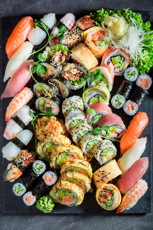 Big sushi set made of fresh vegetables and seafood