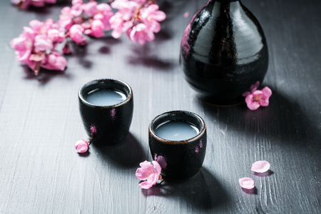 Prepared to drink sake with flowers of blooming cherry