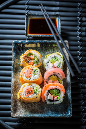 Fresh sushi mix made of salmon and avocado Stock Photo
