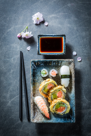 Healthy sushi set made of salmon and avocado Фото со стока