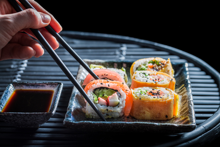Delicious sushi set made of fresh vegetables and seafood
