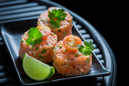 Delicious salmon tartare with coriander and lime