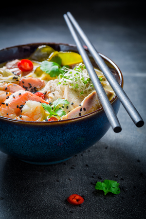 Delicious Malaysian Soup with chicken and shrimps Stock Photo
