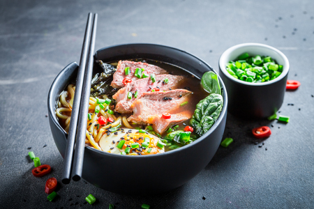 Delicious Ramen soup with noodles and spinach