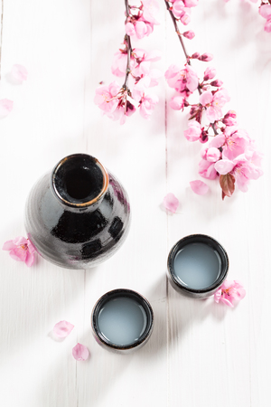 Tasty and strong sake with blooming flowers