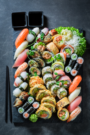 Tasty sushi mix made of fresh vegetables and seafood Фото со стока