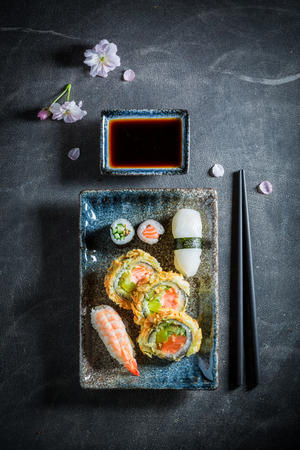 Healthy sushi set made of fresh vegetables and seafood