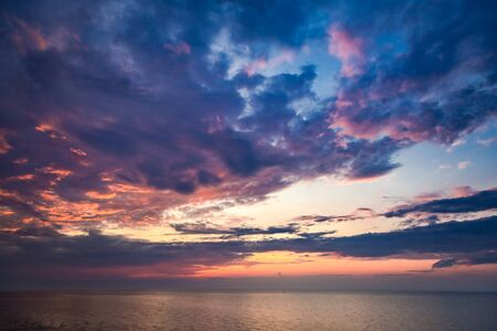 Beautiful sunset over calm sea in summer Stock Photo