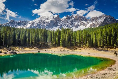 Stunning mountain Carezza lake in Dolomites, Italy, Europe Stock Photo