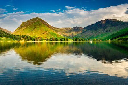 Stunning sunset at lake in District Lake in summer