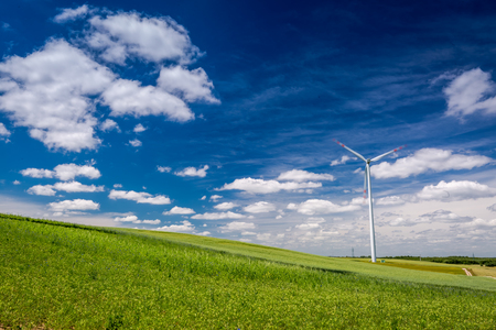 Ecological wind turbines in summer as alternative energy