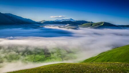 Foggy dawn in the summer mountains, Umbria, Italy