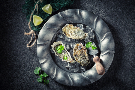 Enjoy your oysters with coriander and lemons