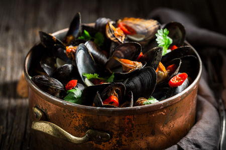 Enjoy your mussels with coriander and chili peppers
