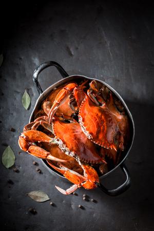 Preparation for tasty crab with allspice and bay leaf Archivio Fotografico