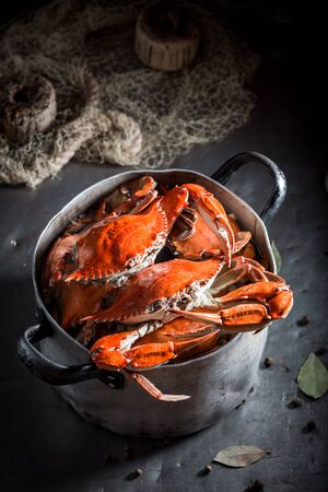 Ingredients for fresh crab in a old metal pot