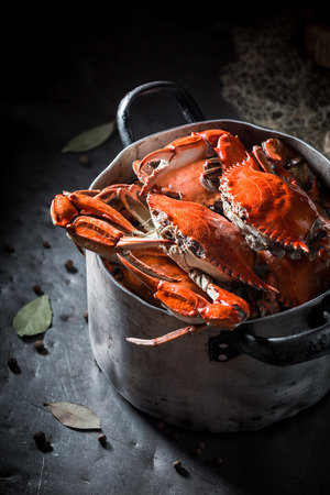 Ingredients for homemade crab with allspice and bay leaf
