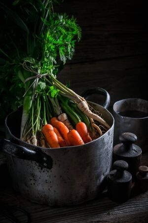 Ingredients for healthy broth with carrots, parsley and leek