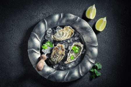 Enjoy your oysters with lemons and coriander