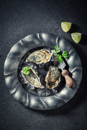 Fresh and delicious oysters with coriander and lemons