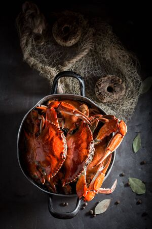 Ingredients for tasty crab in a old metal pot