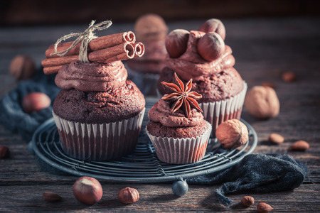Tasty chocolate cupcake made of cream and nuts