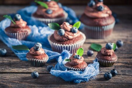 Delicious chocolate muffin with fresh blueberries and cream