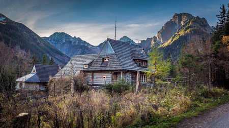 Small hut in the middle of the mountains in autumn