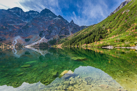 Wonderful lake in the mountains at dawn in autumn Stock Photo
