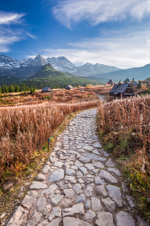 Stunning path to the Tatras at sunset in autumn