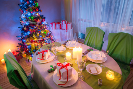 Christmas table setting for Christmas eve in evening