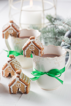 Cute and sweet gingerbread cottages with tasty cocoa for Christmas Stock Photo