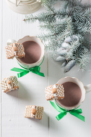 Homemade gingerbread cottages with hot and sweet chocolate Stock Photo