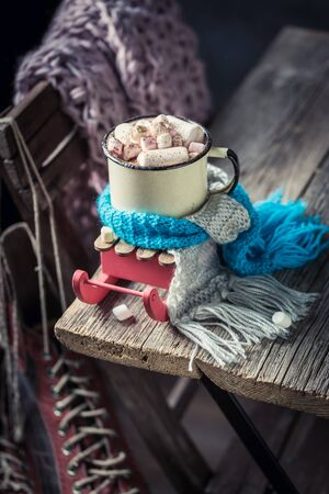 Hot and tasty chocolate with blue scarf for Christmas