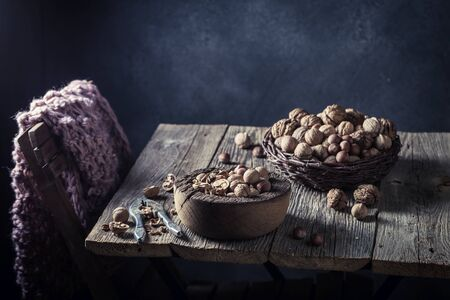 Delicious walnuts and hazelnuts with on rustic table