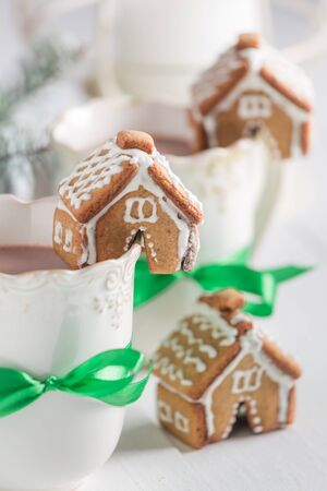 Closeup of gingerbread cottages with hot cocoa for Christmas Stock Photo