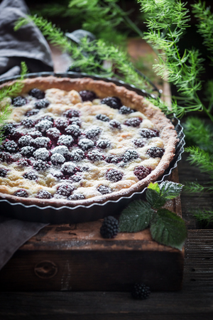 Delicious and sweet tart with blackberries with caster cugar Stock Photo