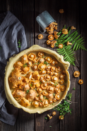 Homemade and rustic tarts with noble mushrooms and thyme Stock Photo