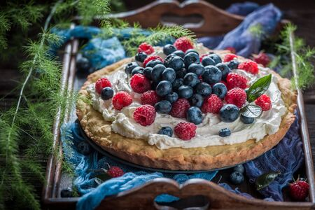 Homemade pie with fresh blueberries and raspberries Stock Photo