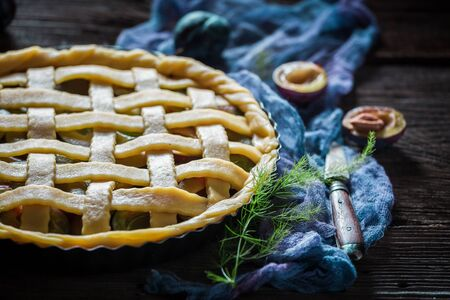 Homemade and delicious plum pie on blue cloth Stock Photo